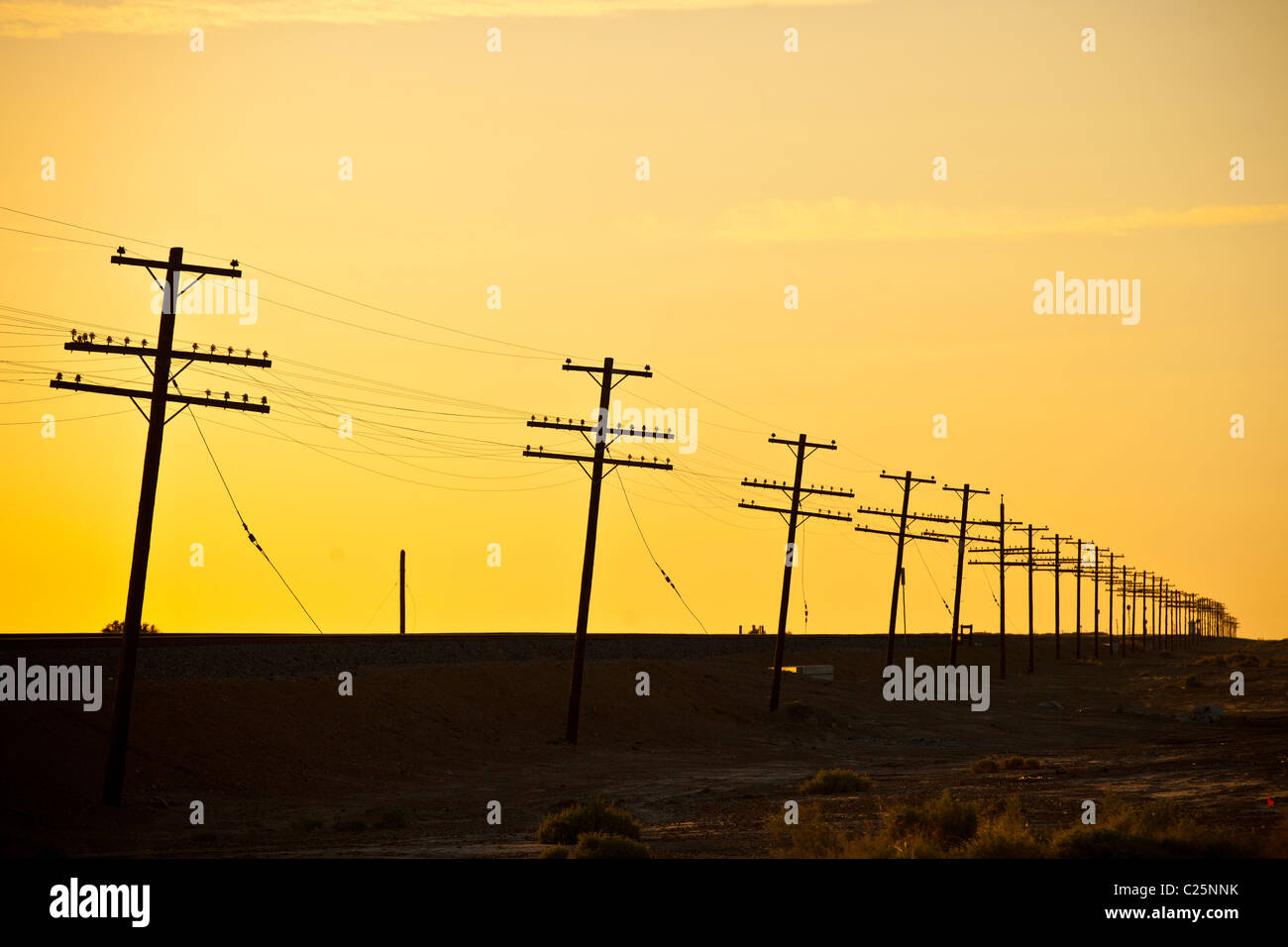Endless line of telephone poles along the coast of the Salton Sea Imperial Valley, CA. Stock Photo
