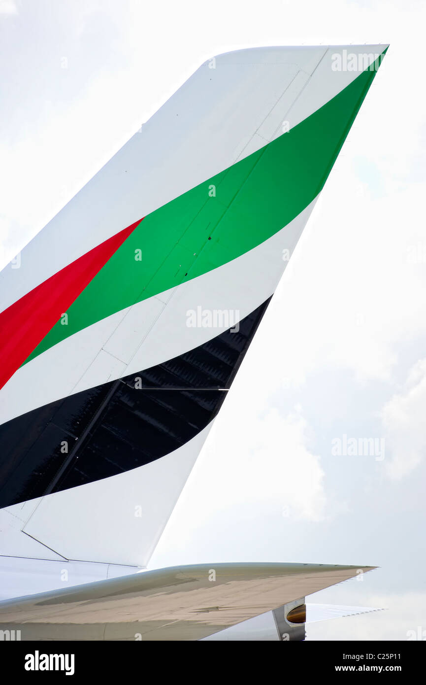 Tail fin of an Emirates aircraft showing logo Stock Photo