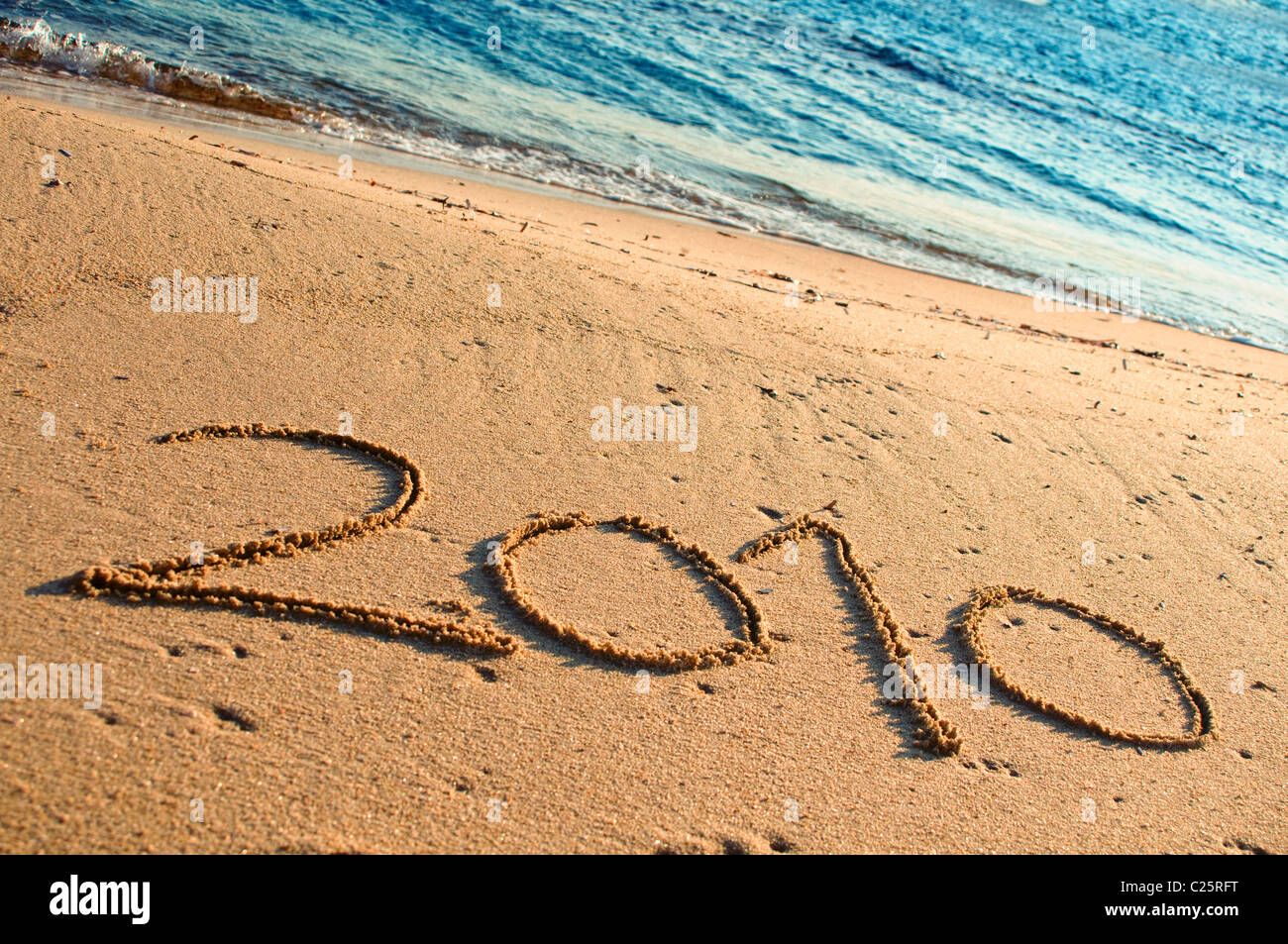 Year 2010 Written in the Sand - Stock Image