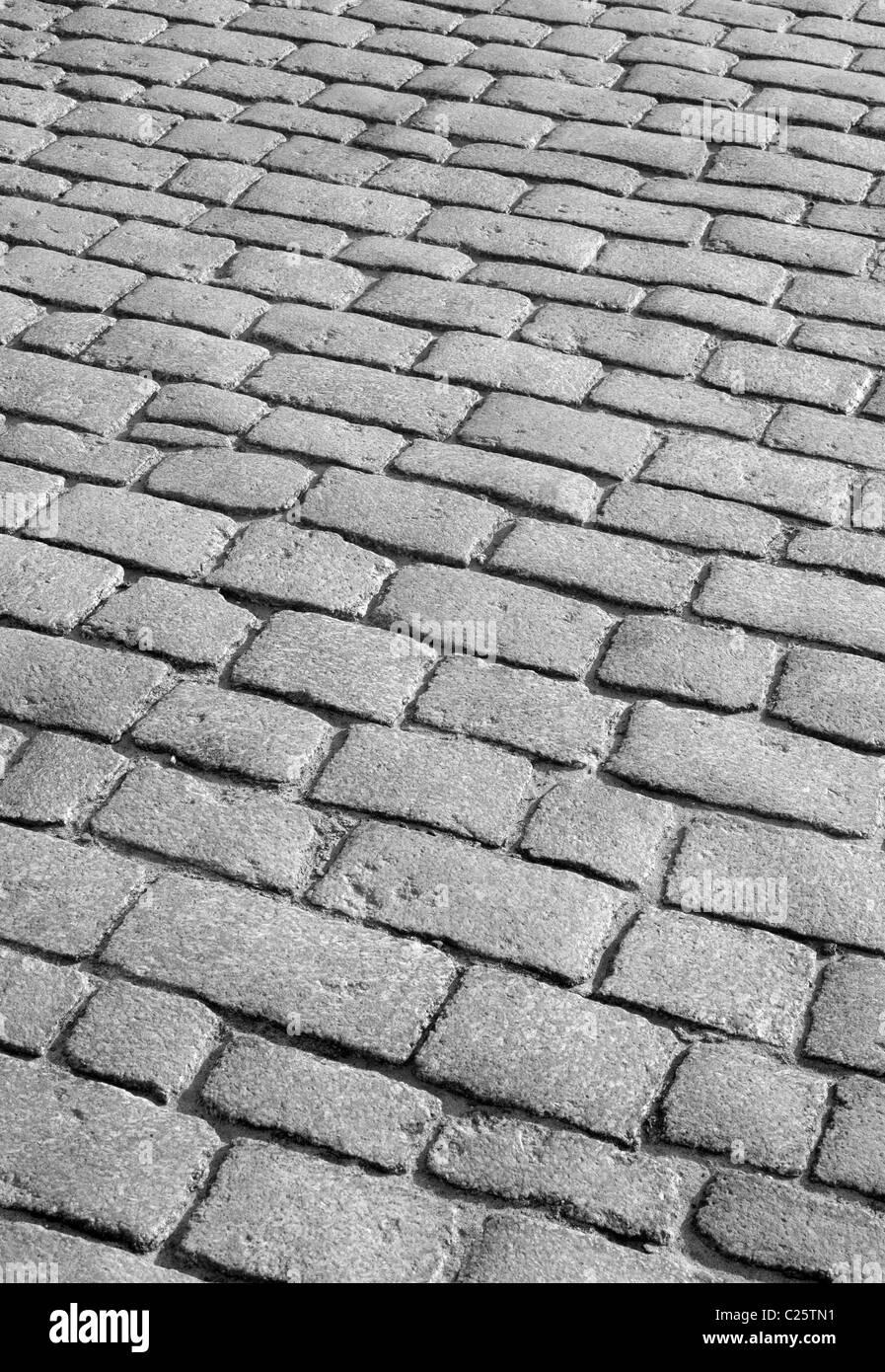 Old English cobblestone road close up. - Stock Image