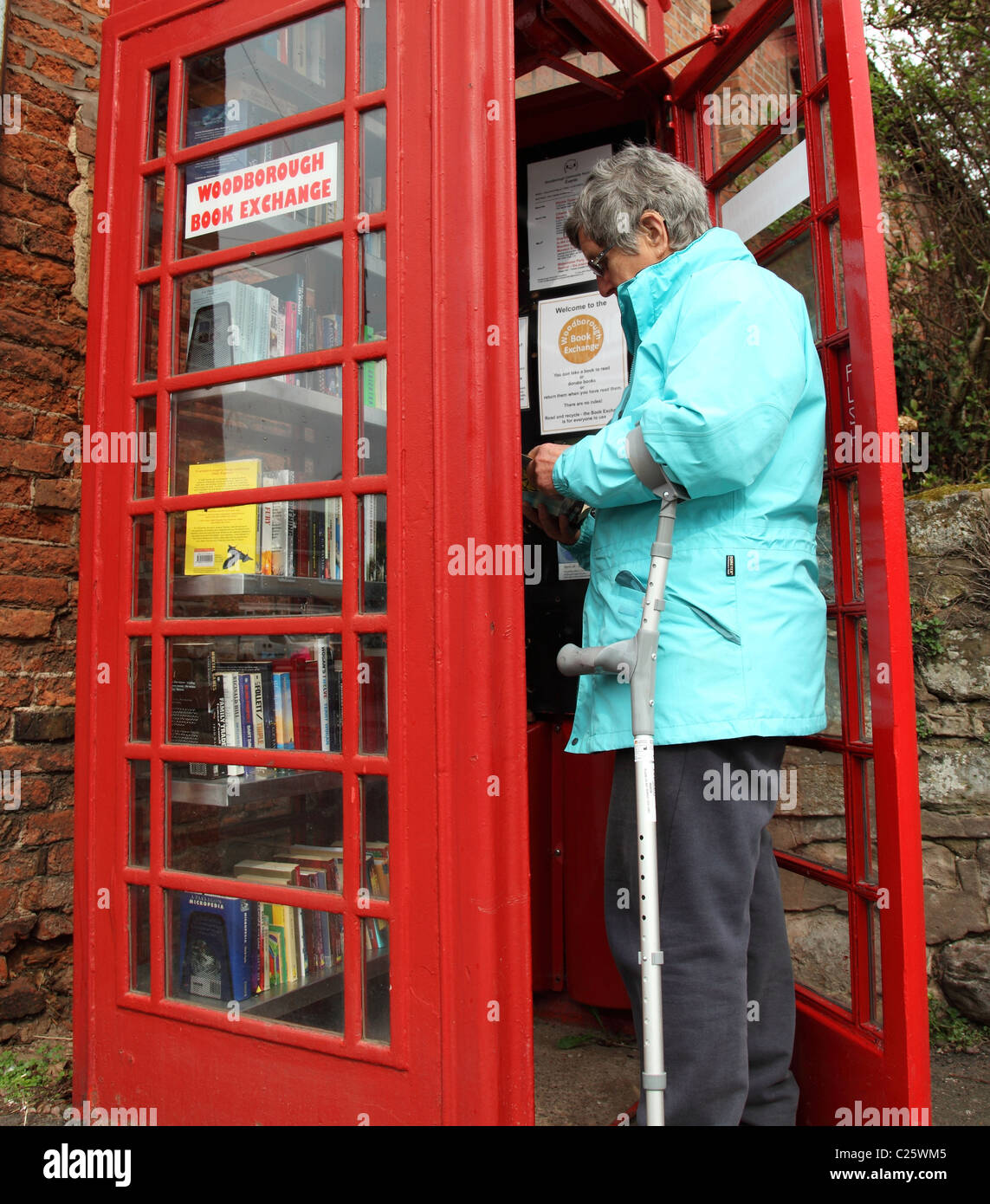 Woodborough Book Exchange in a converted telephone box in the village of Woodborough, Nottinghamshire, England, - Stock Image