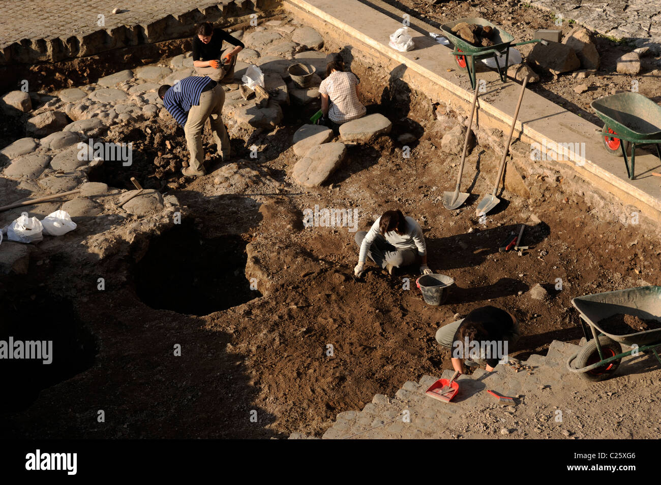 italy, rome, archaeological dig in the forum boarium, archaeologists working - Stock Image