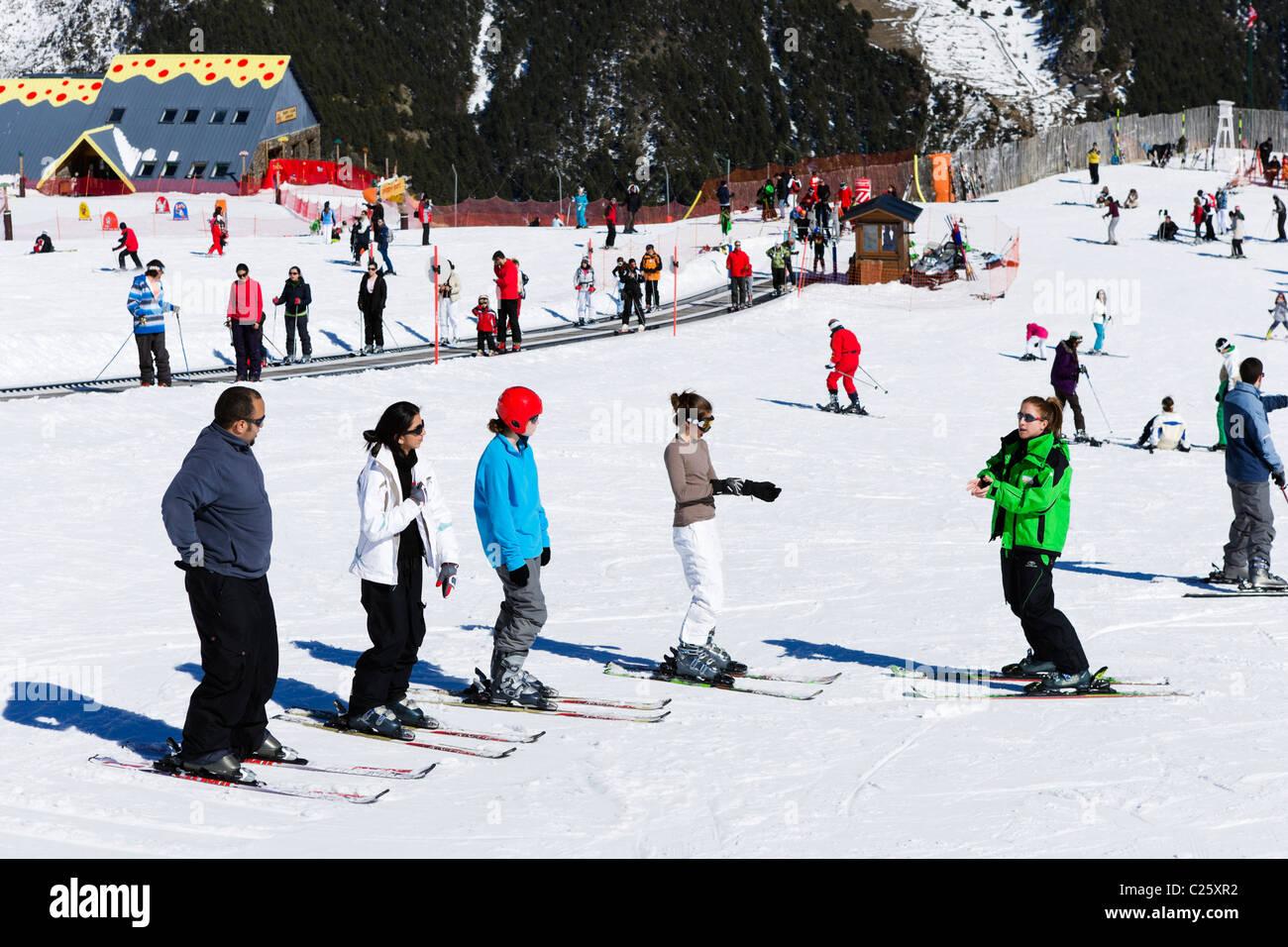Ski school on the nursery slopes at Comallempla, Arinsal, Vallnord Ski Area, Andorra - Stock Image