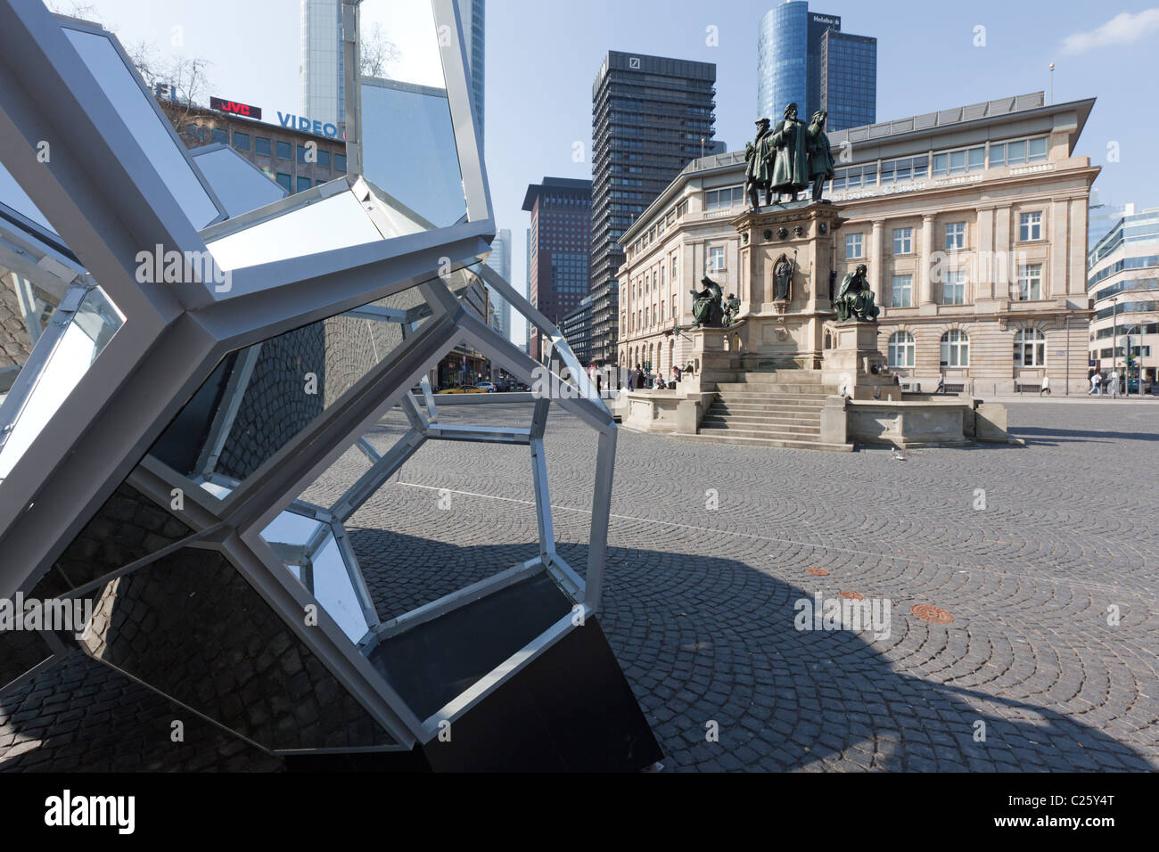 Two art works with more than 150years between them at Goetheplatz, Frankfurt, with the city skyline behind - Stock Image
