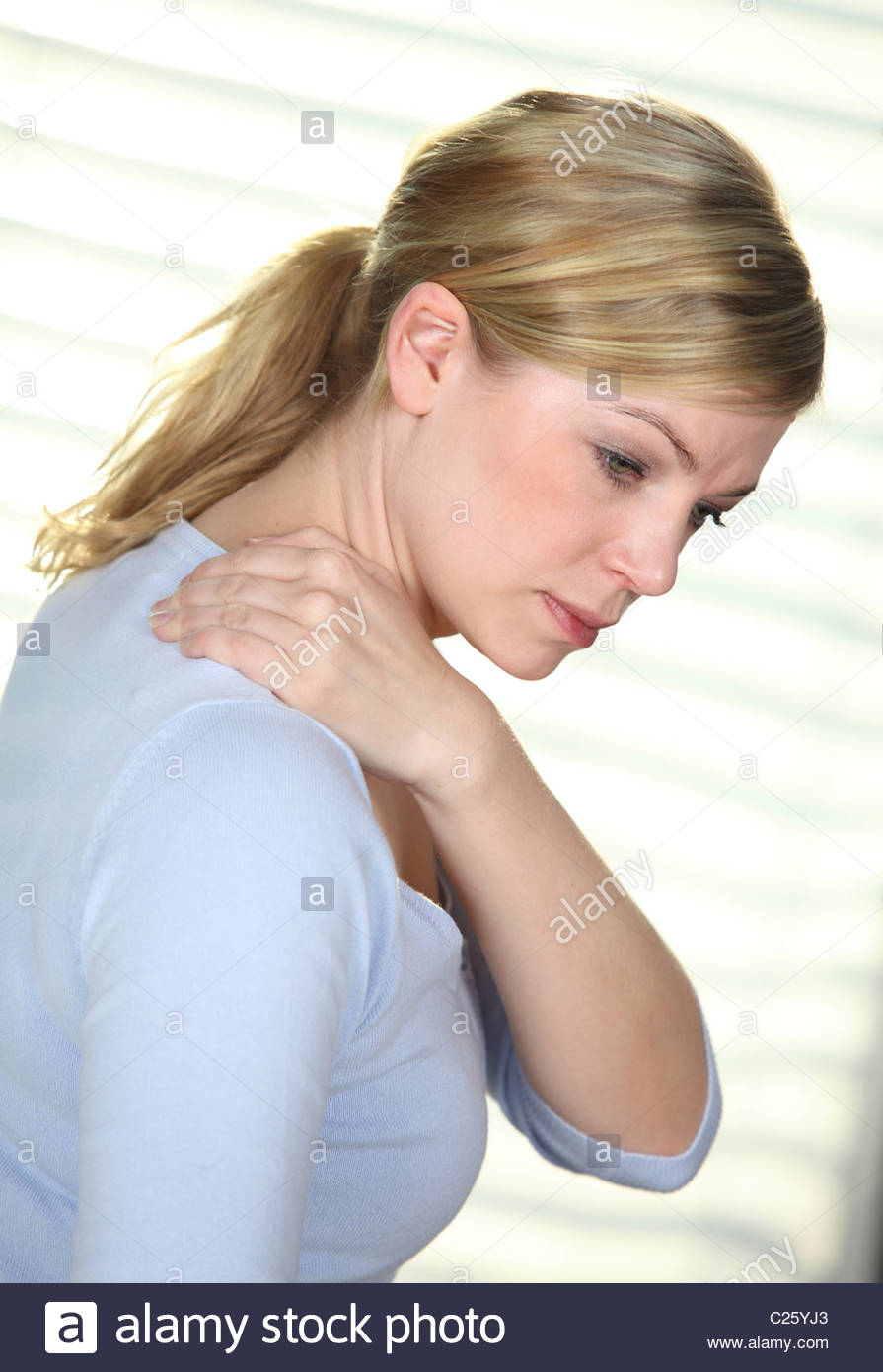 woman with neck pain - Stock Image