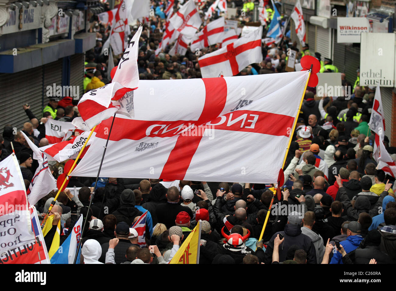 large crowds with england flags and banners at the english defence
