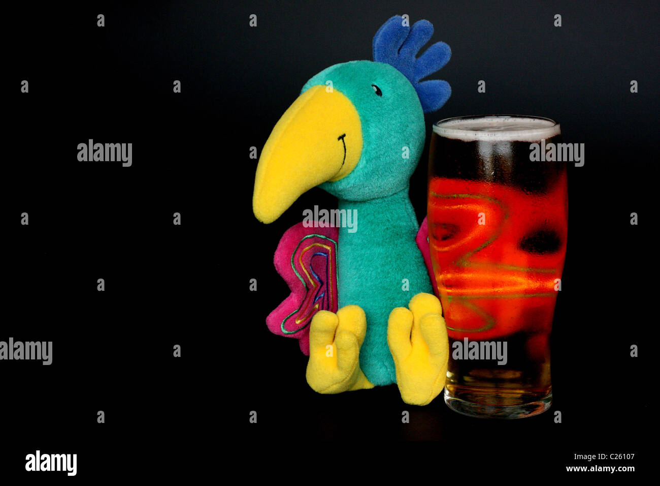 toy parrot with pint of larger - Stock Image