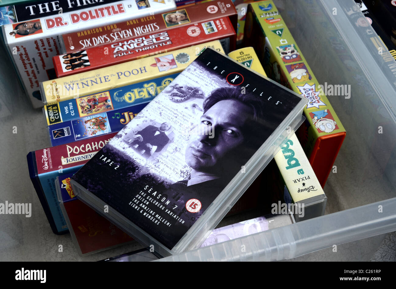 Video Tapes for sale outside a charity shop in Edinburgh, including a copy of the X-Files season 7. - Stock Image