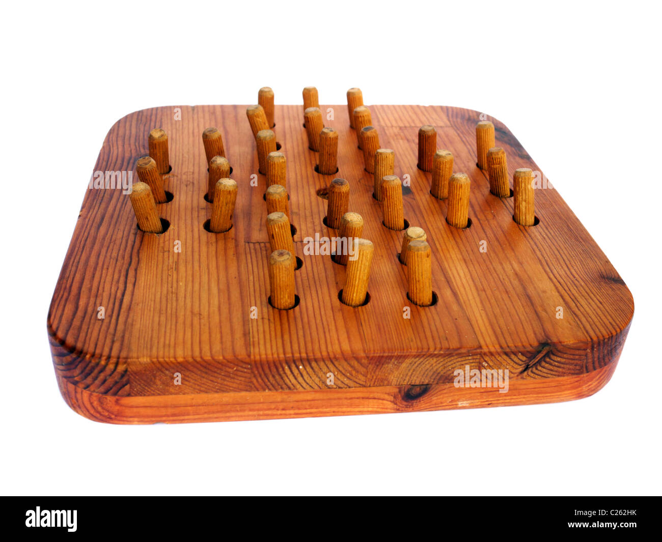 A Peg Solitaire board - Stock Image