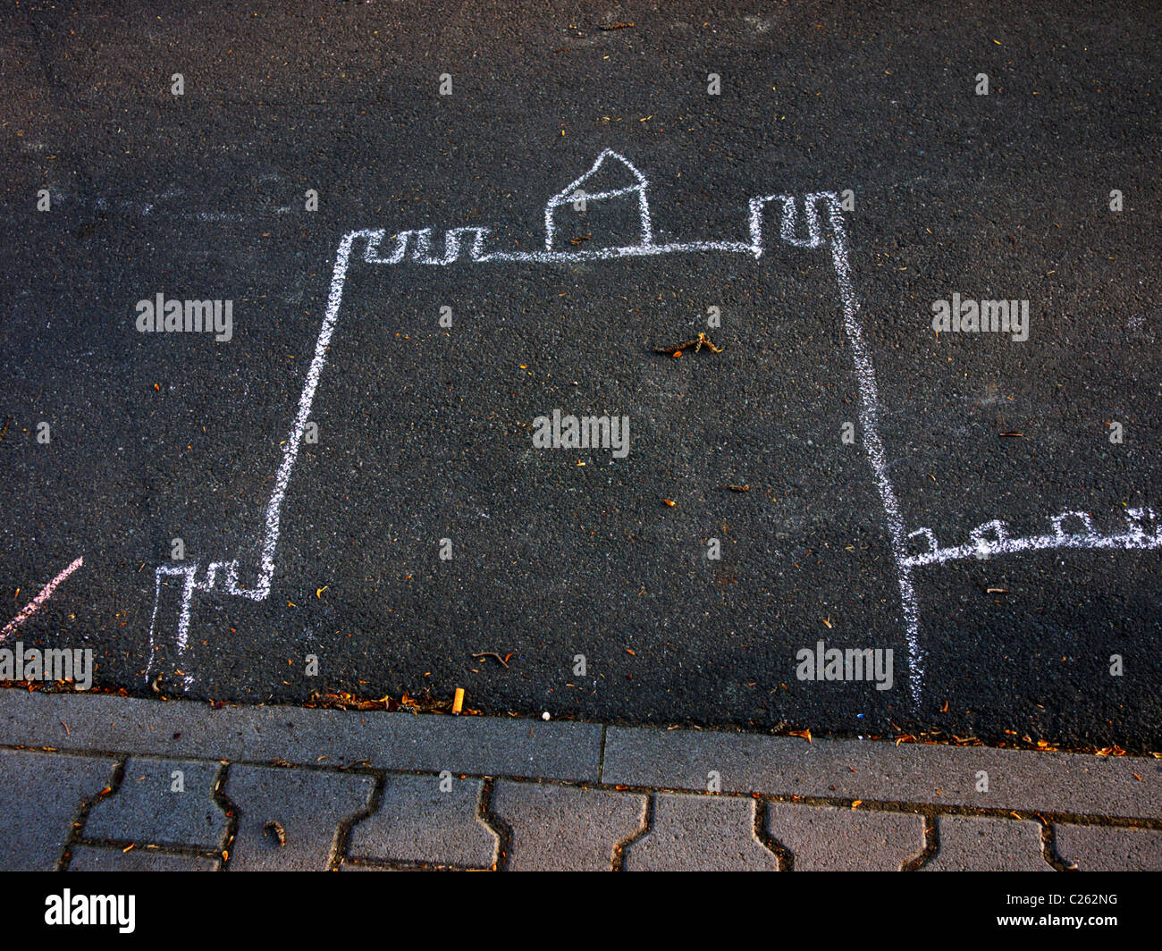 Chalk drawing depicting a castle on the street - Stock Image