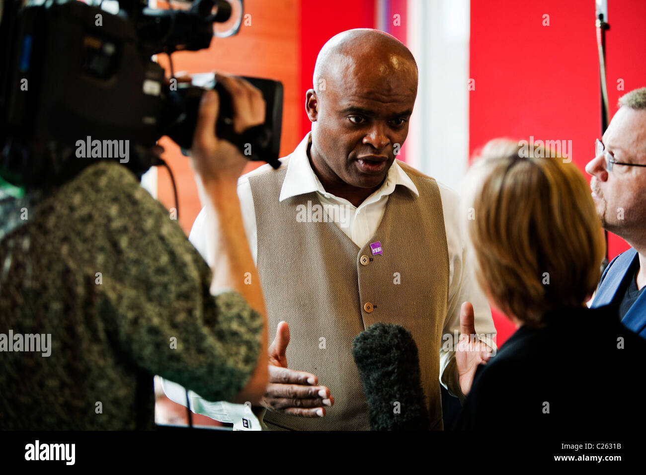 Ex-Olympic athlete Kriss Akabusi, gives an interview during the launch of the YES! to Fairer Votes campaign launched - Stock Image