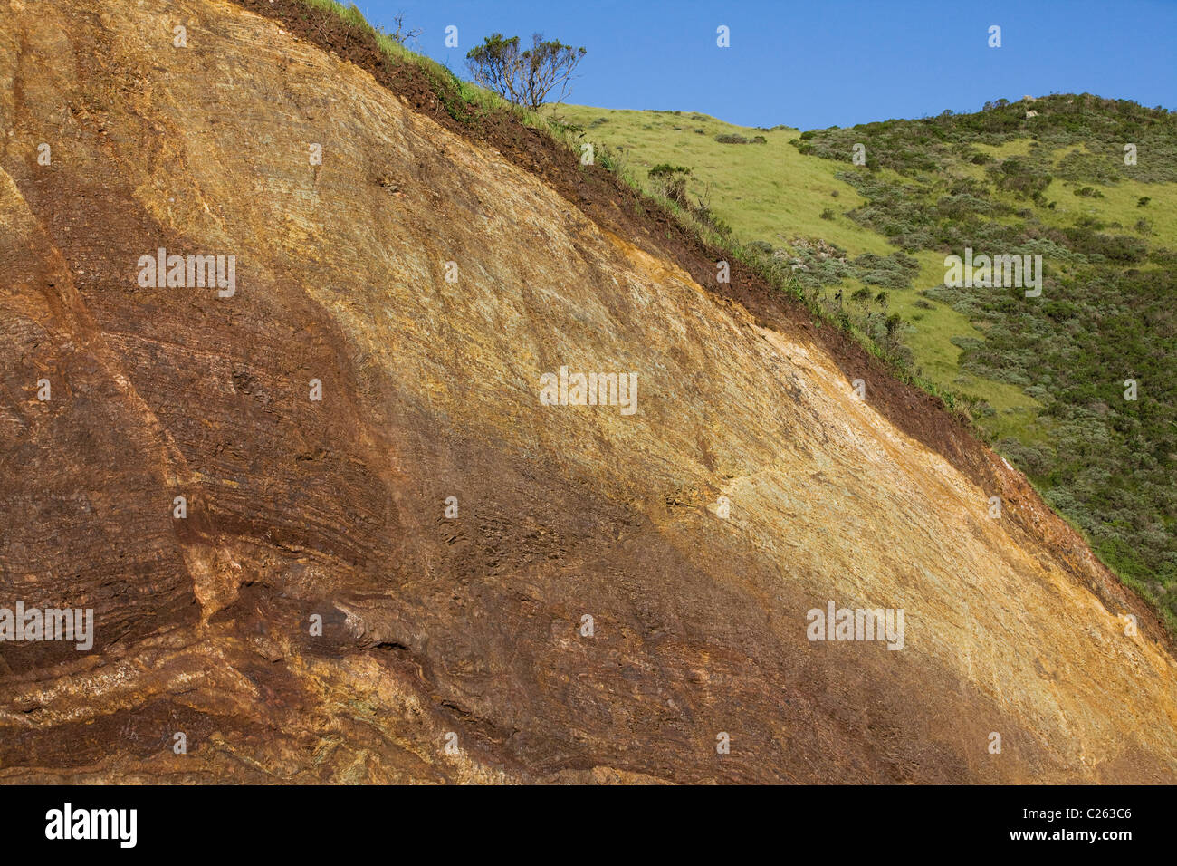 A cross section view of hillside, showing layers of differing soil and rock - California USA - Stock Image