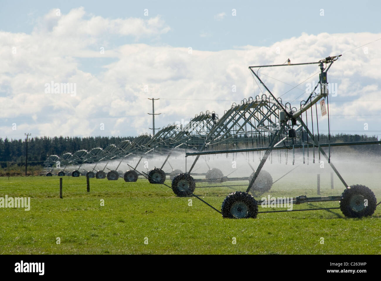 Mobile irrigation sprinkler system in use on the Canterbury Plains, New Zealand - Stock Image