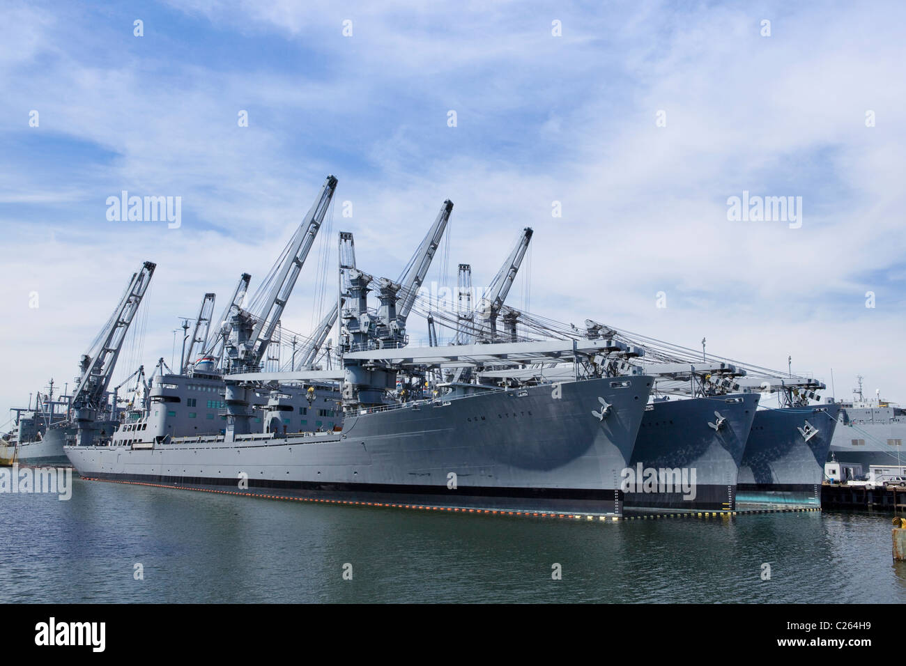US Navy Keystone State Class Auxiliary Crane Ships docked in port - Alameda, California USA - Stock Image