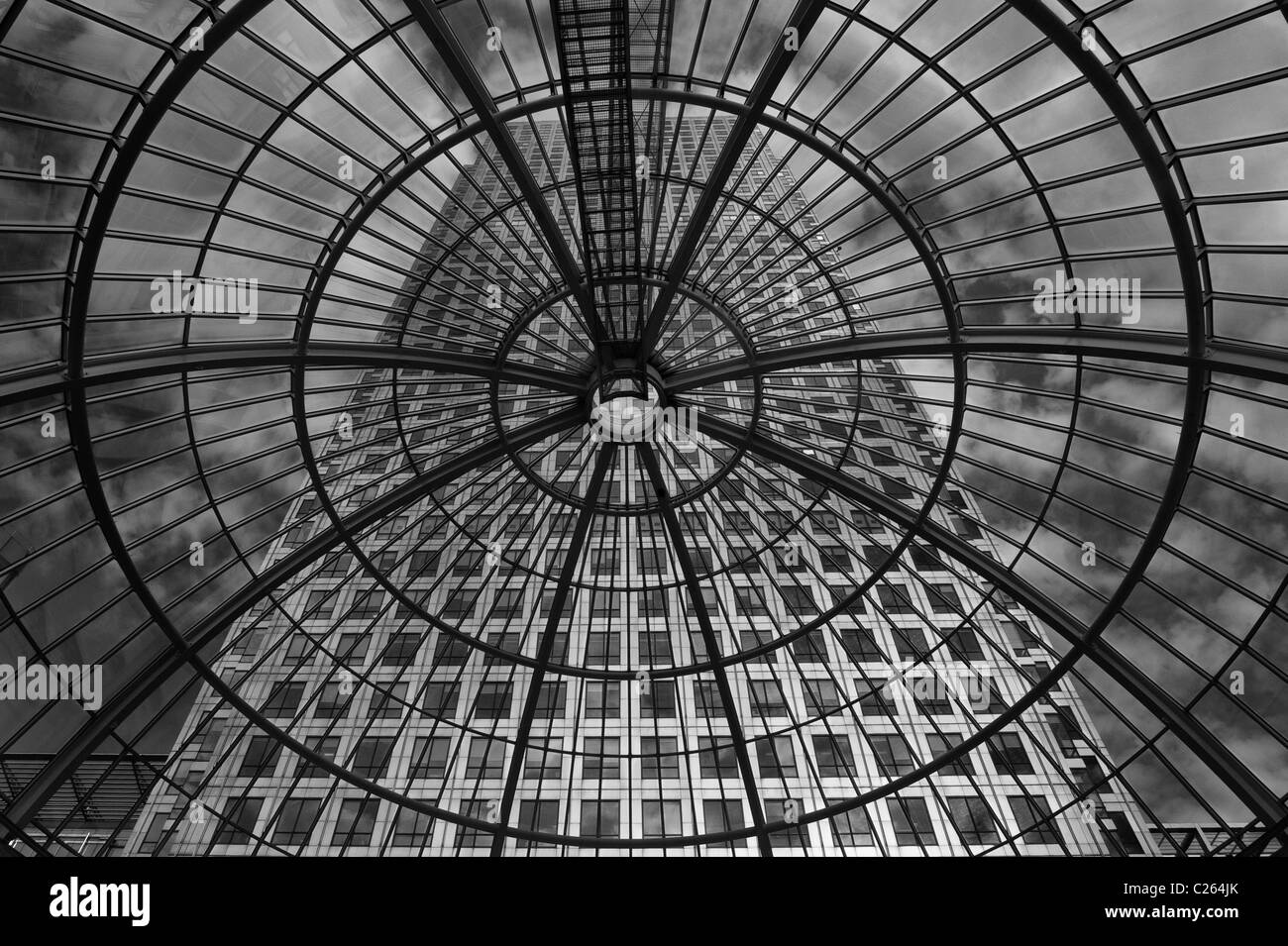 Canary Wharf shot through the glass dome of Cabot Place, Docklands, London - Stock Image