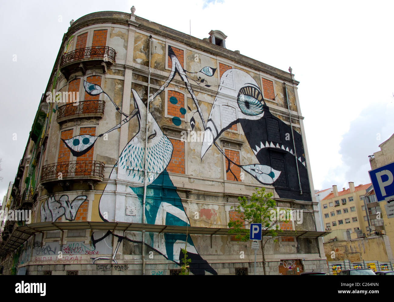 Street art and graffiti on unused buildings in the Portuguese capitol of Lisbon - Stock Image