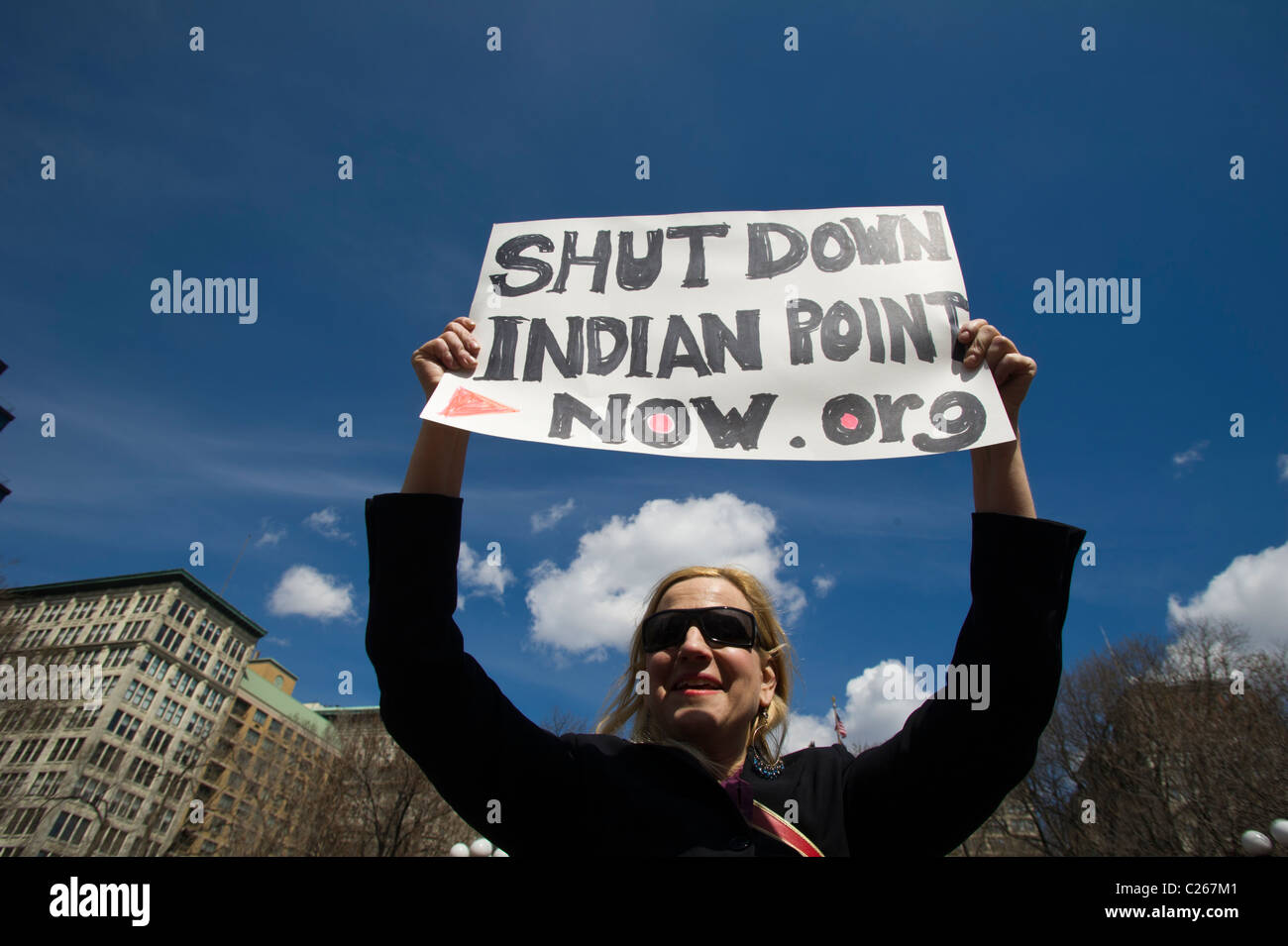 Activists from the newly formed 'Shut Down Indian Point Now!' protest in Union Square Park in New York - Stock Image