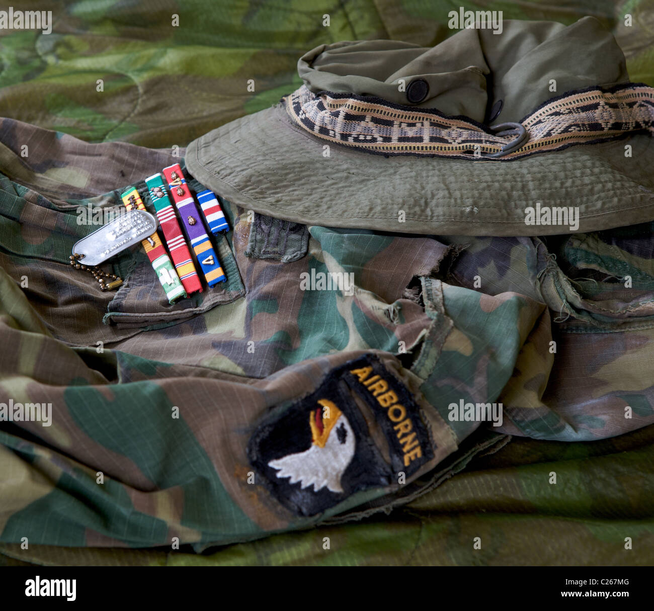 c6698c45c09b8 Camouflaged military jacket circa 1970 Vietnam with ribbons (Medals) dog  tag and boonie hat