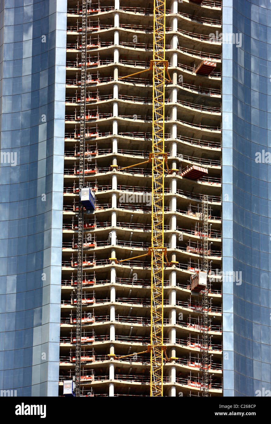 Construction site of new skyscrapers in the city center of Abu Dhabi, United Arab Emirates. - Stock Image