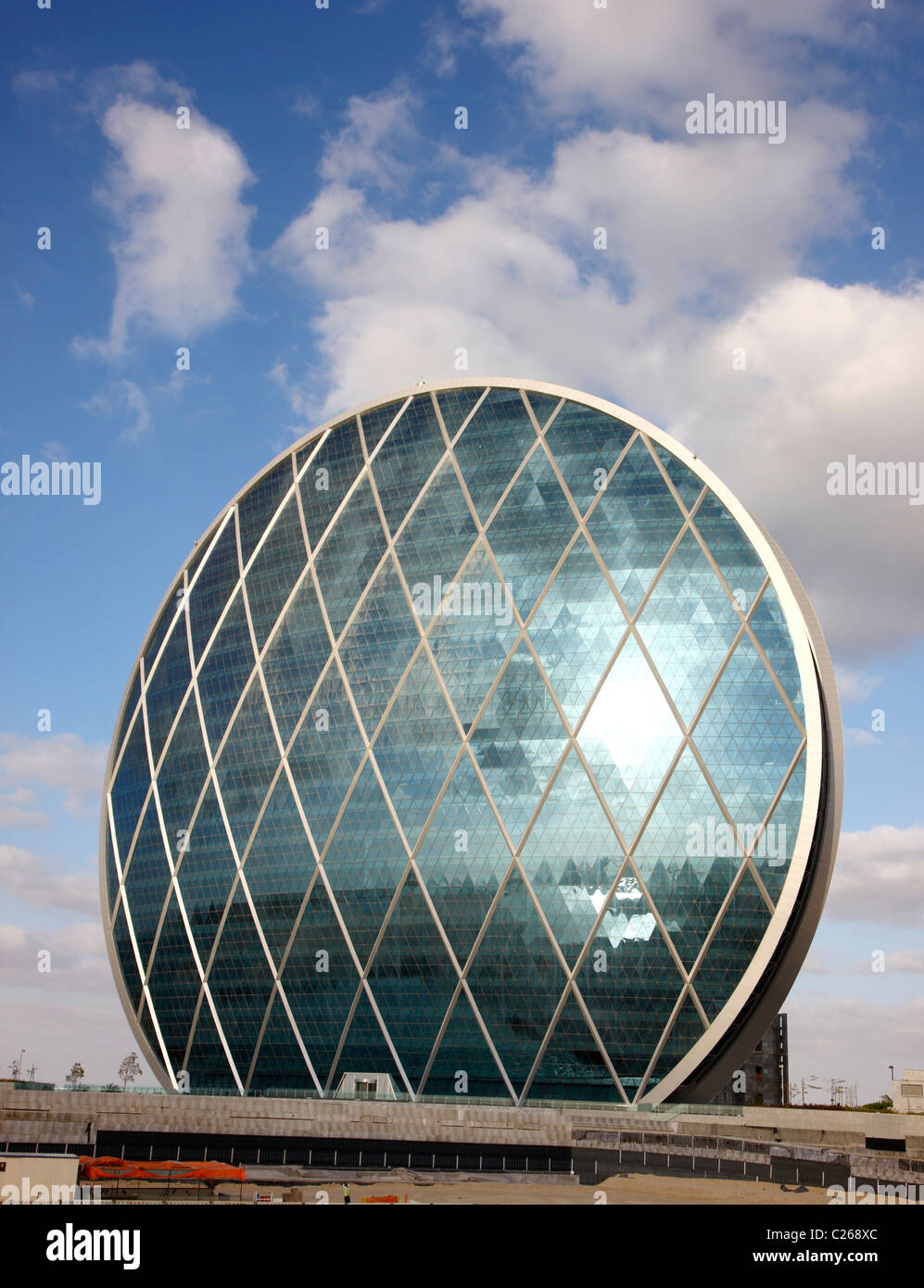 Headquarter of real estate company ALDAR, in a round shape. Called 'The Coin'. Abu Dhabi, United Arab Emirates. - Stock Image