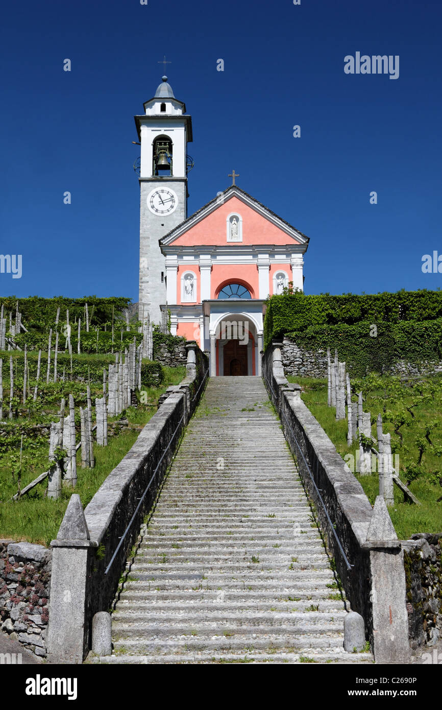 long flight of stairs leading up to a charming bright church on a hill, concept for path to religion, belief, Jesus, - Stock Image