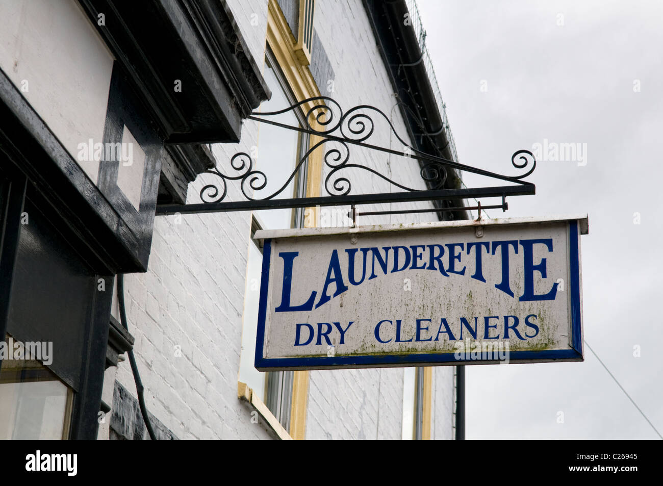 Old fashioned launderette sign taken in Upton upon Severn, Worcestershire, England, UK - Stock Image