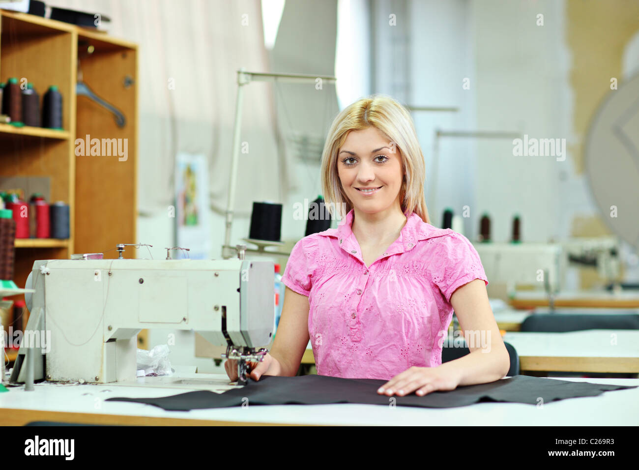 Female worker in a textile factory - Stock Image