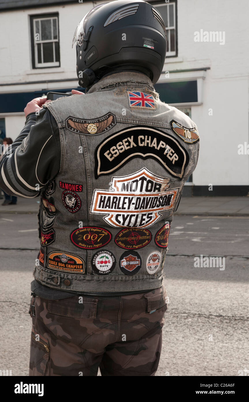 Harley Davidson motorcycle owner from the Essex Chapter wearing his badges at the Ride of Respect parade Stock Photo