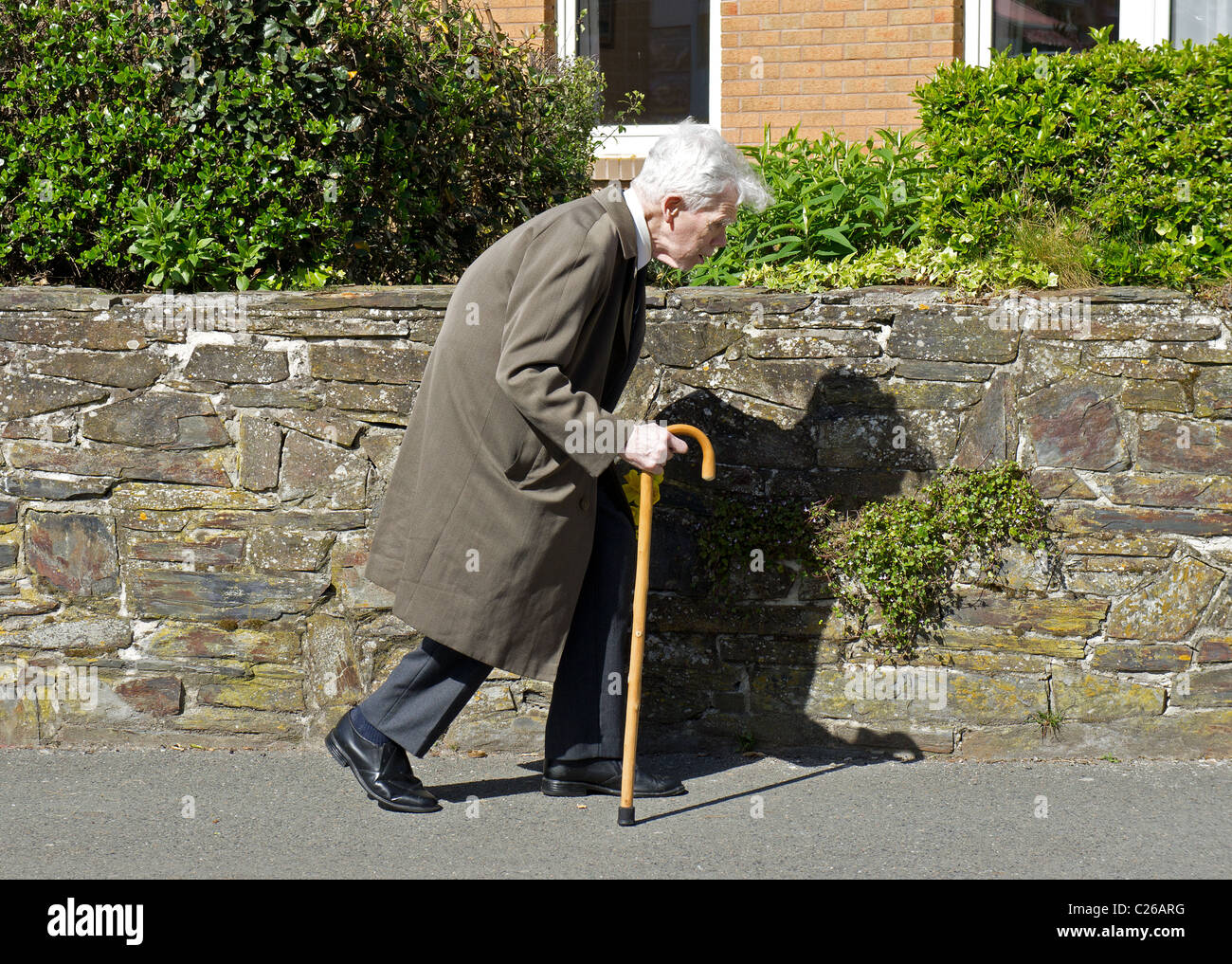 Old Man Walking Bent High Resolution Stock Photography and Images - Alamy