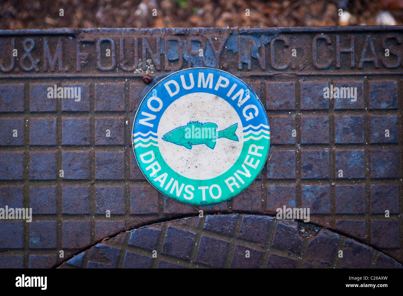 No dumping sign on a drain in Charleston, SC. - Stock Image
