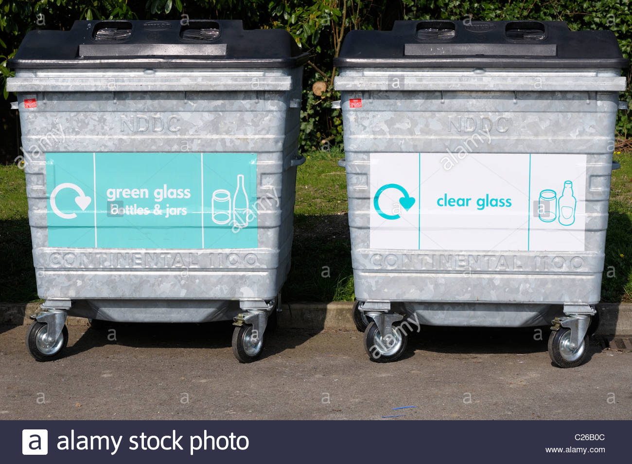 Straight on image of glass recycling bins at Blandford Forum in Dorset, England - Stock Image
