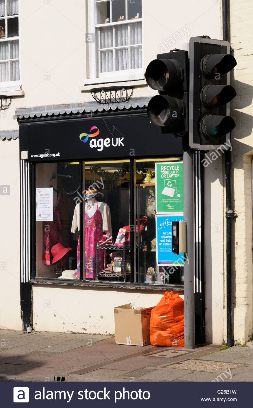 View across the road of the Age UK charity shop at Blandford Forum in Dorset, England - Stock Image