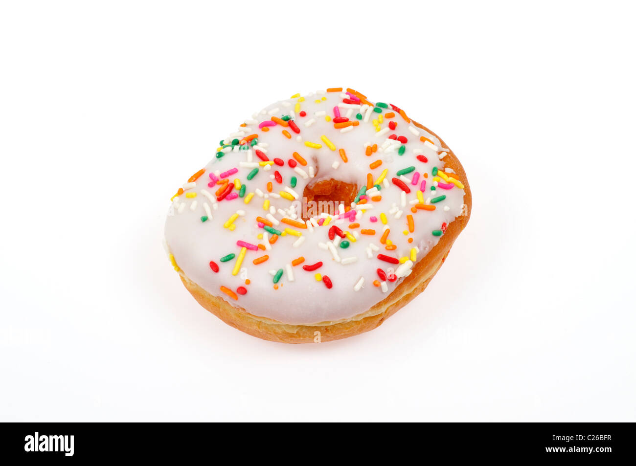 Vanilla frosted ring doughnut with colorful sprinkles on white background cut out - Stock Image