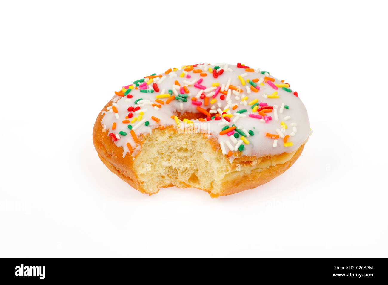 Partially eaten vanilla frosted donut with sprinkles on white background cut out - Stock Image