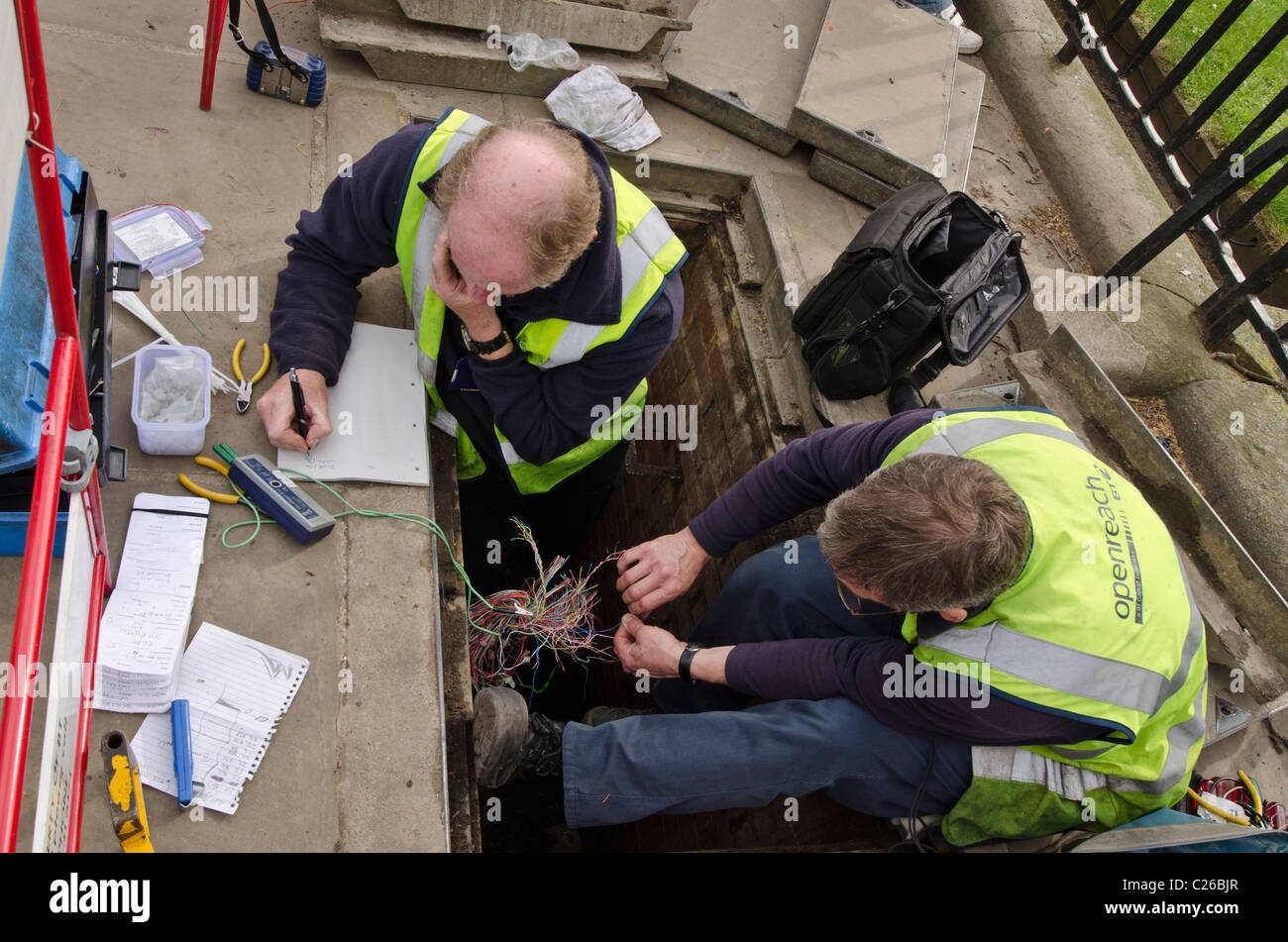 Bt Telephone Engineers In Manhole Stock Photos Phone Cable Wiring Repairing Cables And Wires London Uk Image