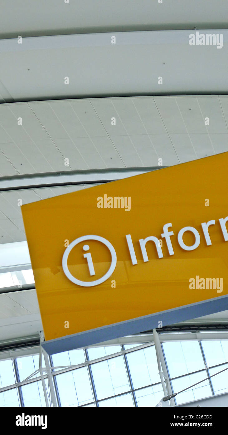 Information signage in airport terminal. - Stock Image