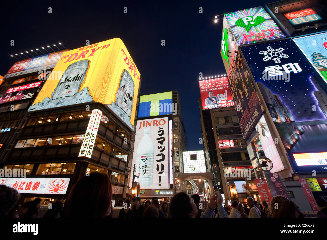 Bright neon lights of restaurants and clubs in Dotombori area at night in Osaka, Japan. - Stock Image