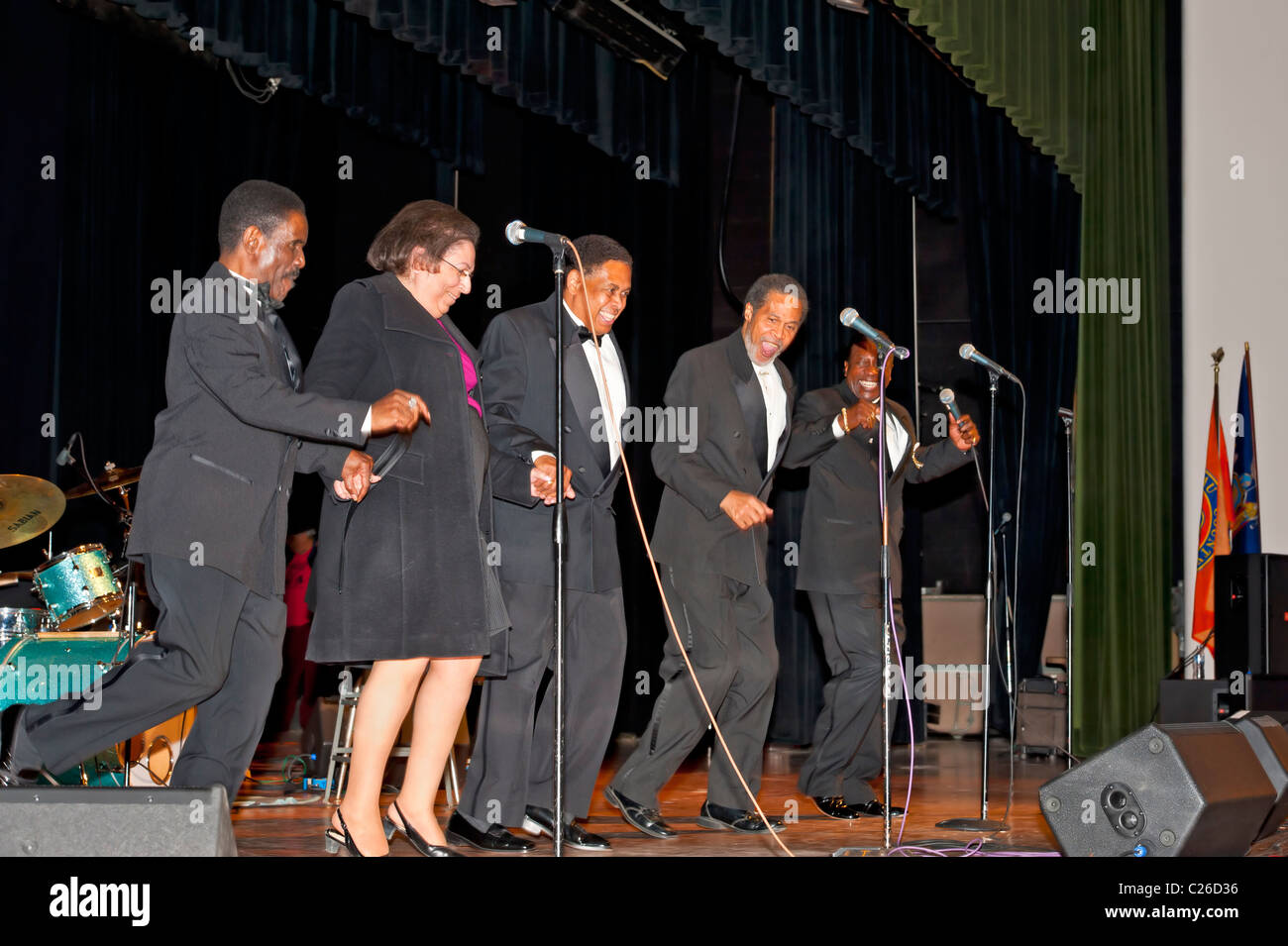 APR 2 2011 - BELLMORE, NY: Audience participation at Doo Wop concert, Fan dancing on stage The Original Cornell - Stock Image