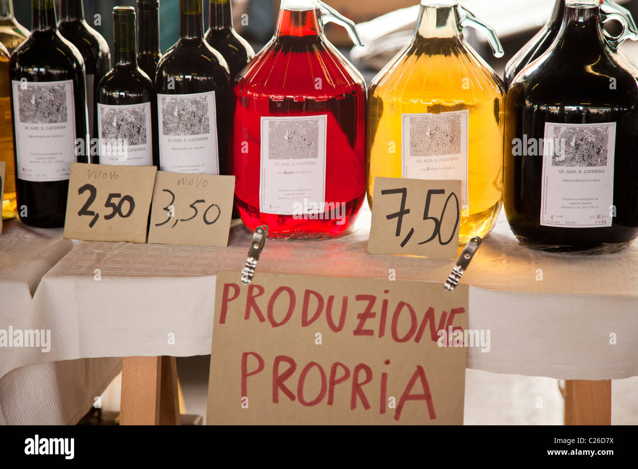 Bottles of local wine displayed at a market in Florence Italy. - Stock Image