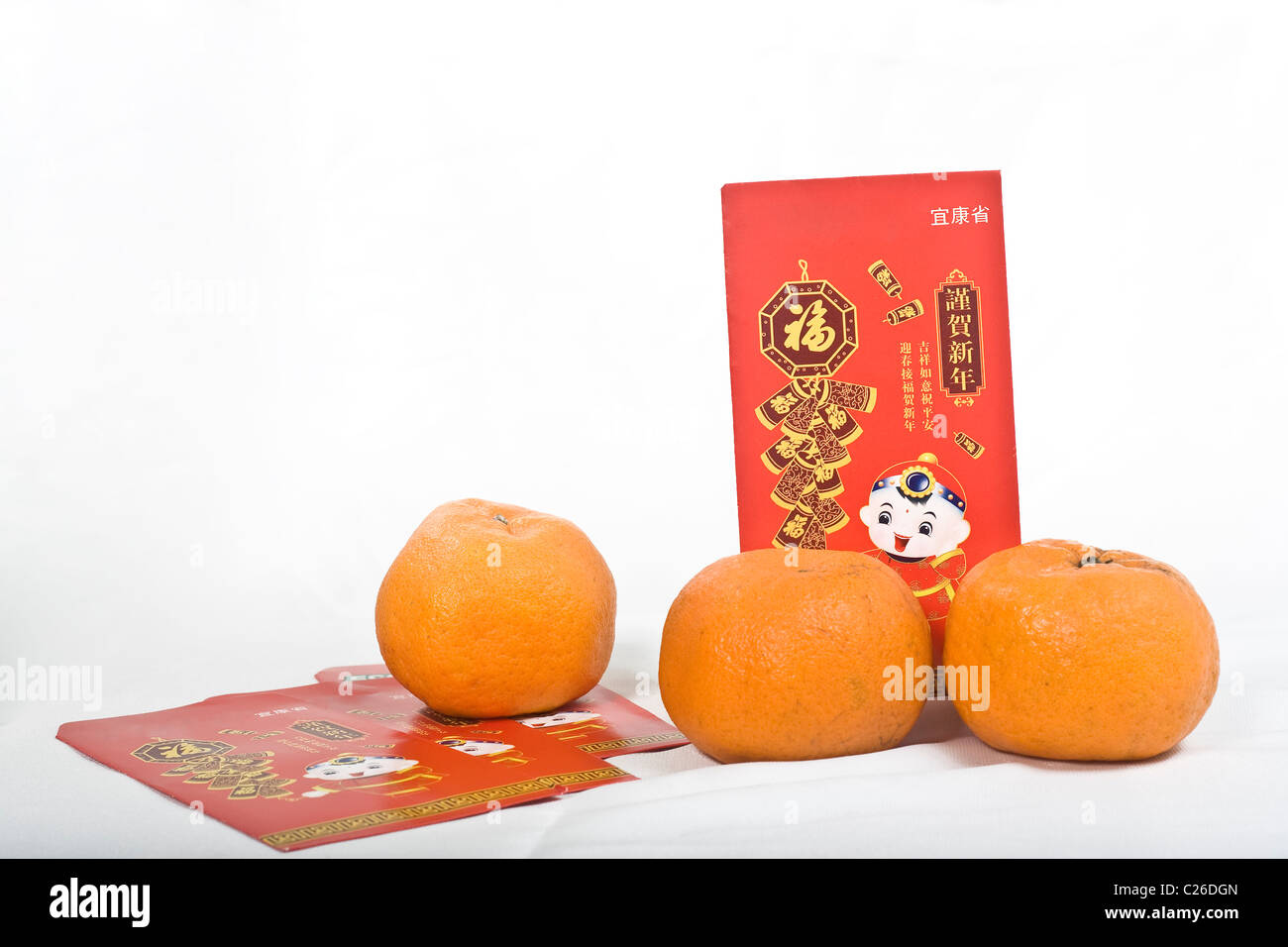 Mandarin oranges and Chinese New Year Red Packet - Stock Image