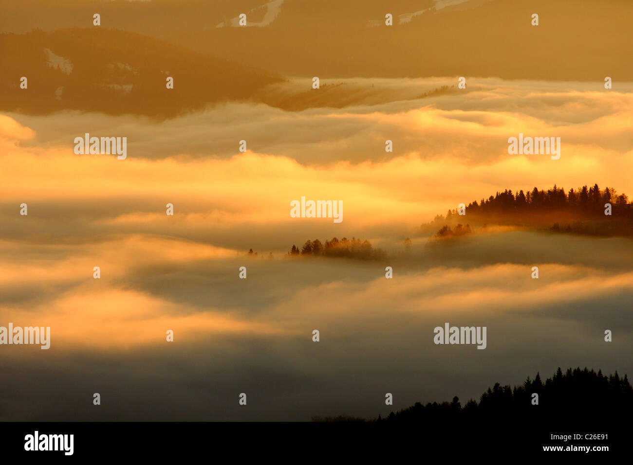 Morning clouds and fogs in polish mountains - sunrise in Beskid Sadecki, Poland - Stock Image