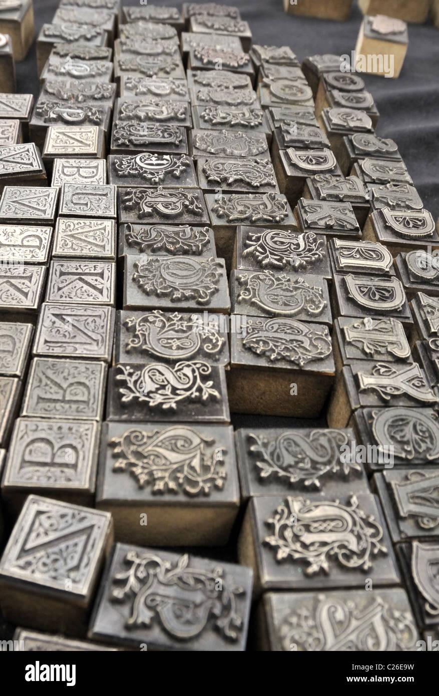 Metal typesetting sorts at Greenwich market, London, UK. - Stock Image