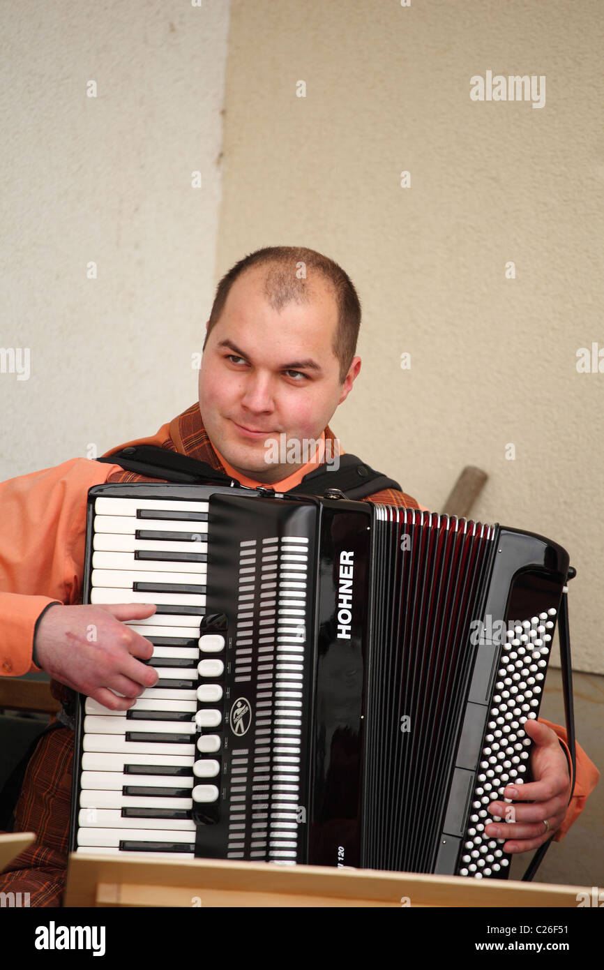 Musician from the old time band Funny Fellows playing on the accordion. - Stock Image