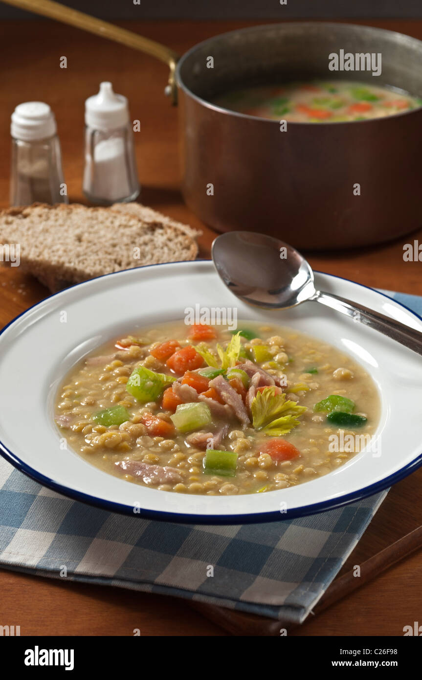 London Particular soup. Ham and yellow pea soup - Stock Image