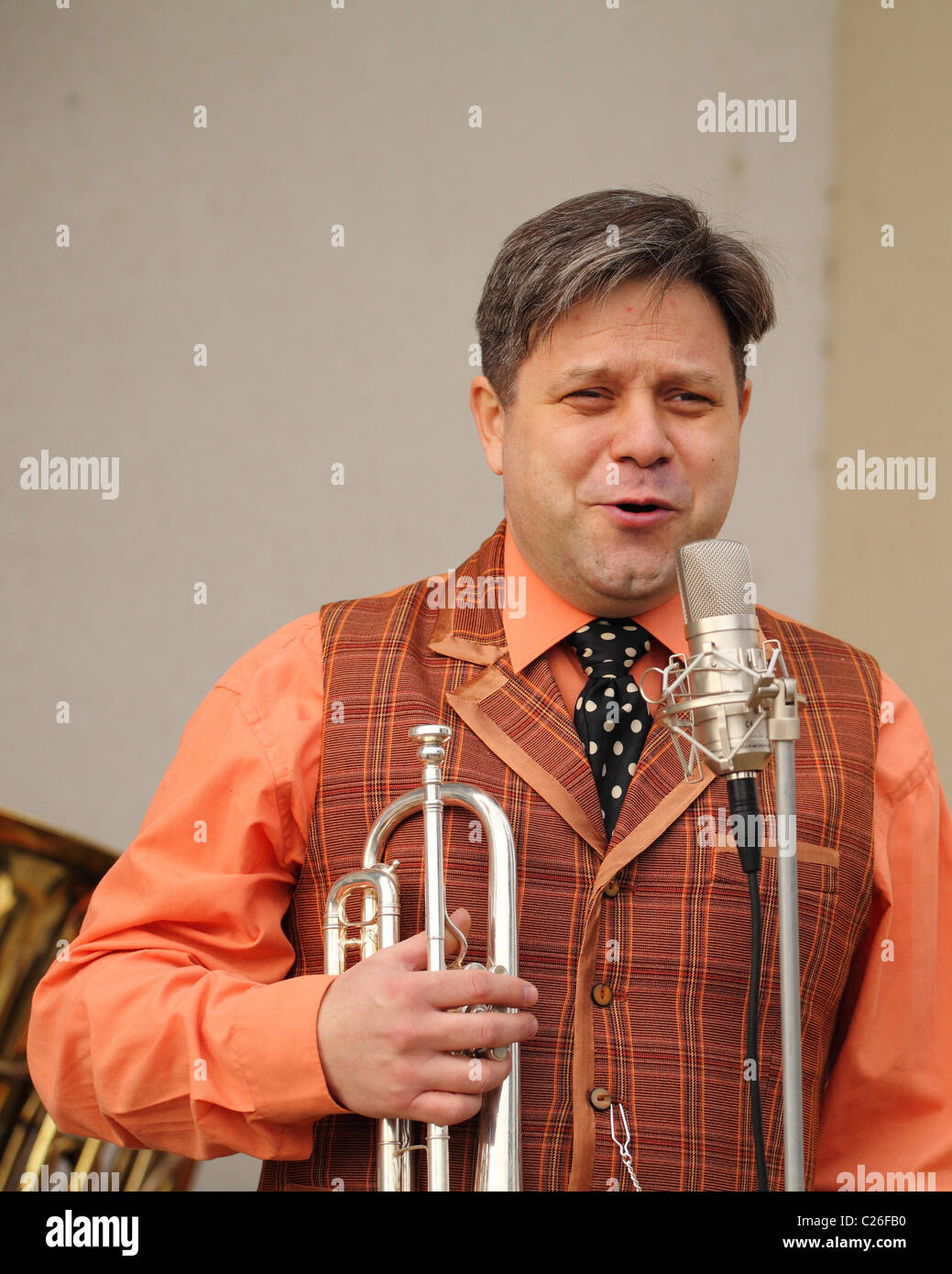 Musician from the old time band Funny Fellows with the jazz trumpet. - Stock Image