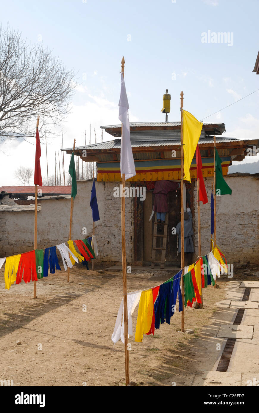 Entrance of the monastery in Ura, central Bhutan, being prepared for a special visitor - Stock Image