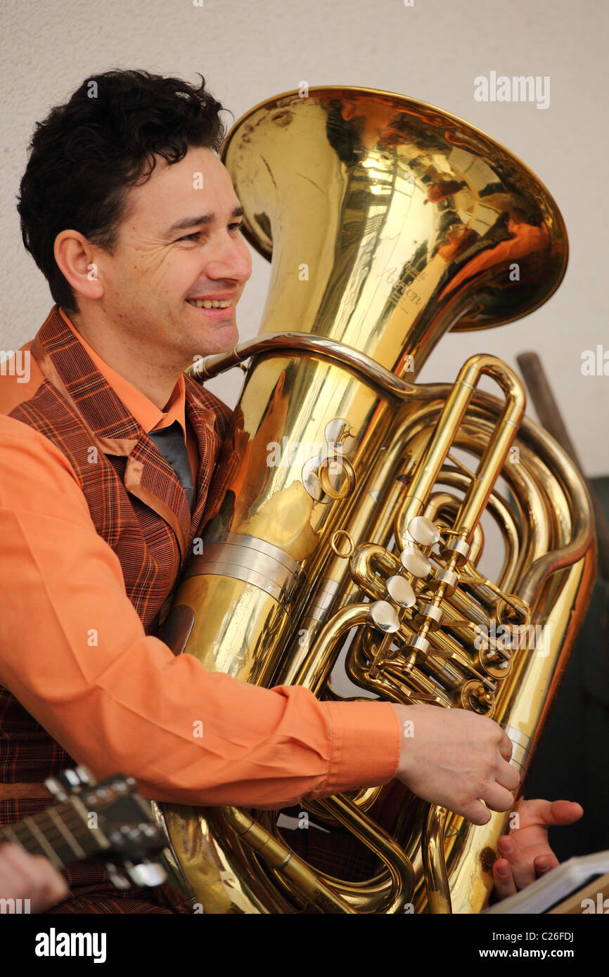 Musician from the old time band Funny Fellows with the bass tuba. - Stock Image