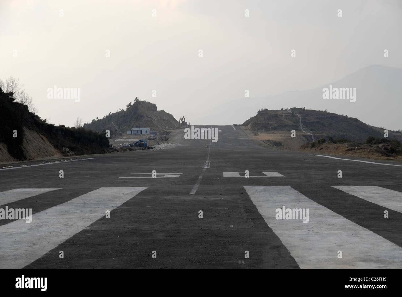 Construction work at the new Runway / Airport above Trashigang, East Bhutan - Stock Image