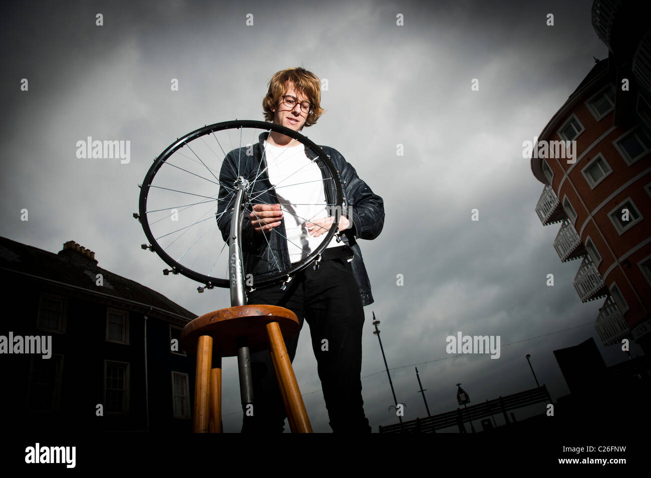 Aberystywyth university art student JOE SCOTT with his kinetic sculpture based on a bicycle wheel, - Stock Image
