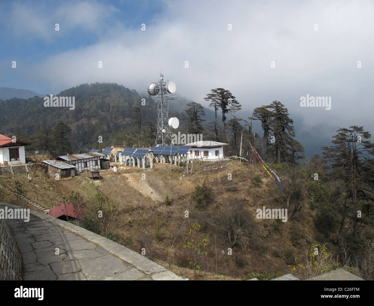Photo-voltaic systems and telecommunication antennas, Dochula Pass, Bhutan - Stock Image